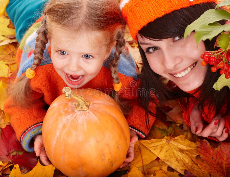 Happy family child autumn orange leaf, pumpkin stock photography