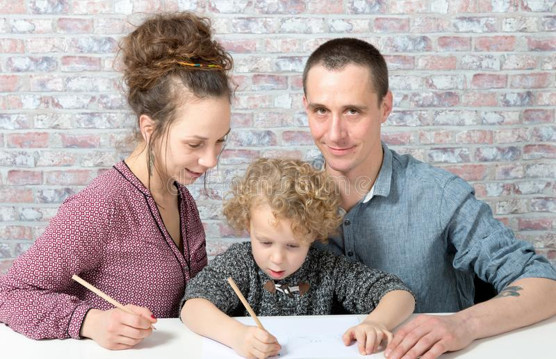 Happy family, child, father and mother drawing royalty free stock images