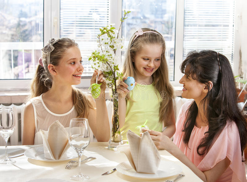 Happy family with child hang easter egg. royalty free stock images