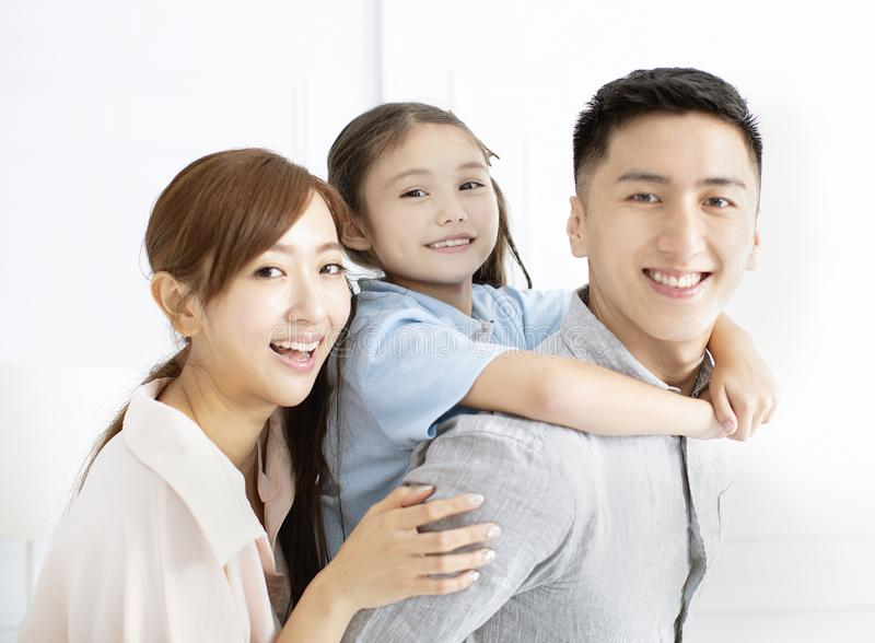 Happy family and child having fun together stock photo