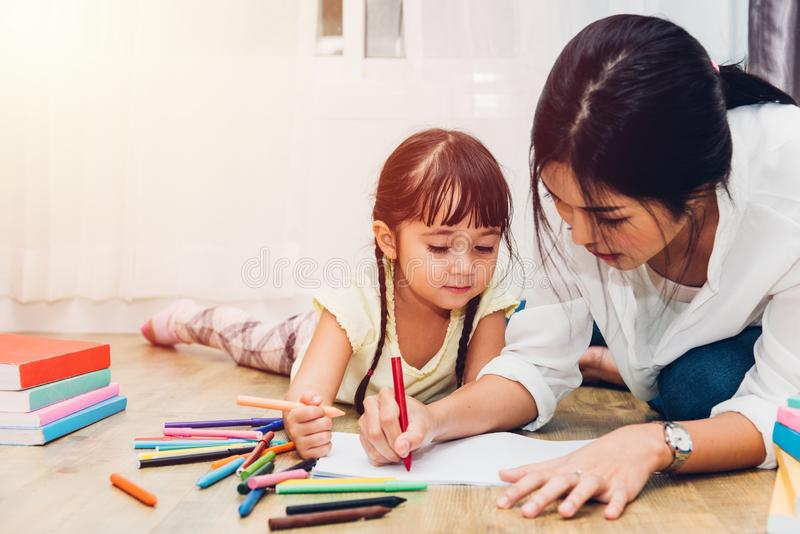 Happy family child kid girl kindergarten drawing teacher education mother mom with beautiful mother royalty free stock photos