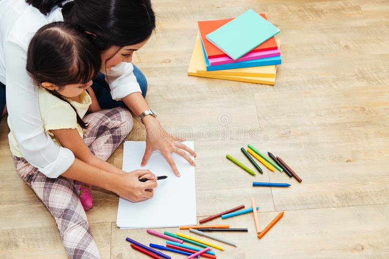 Happy family child kid girl kindergarten drawing teacher education mother mom with beautiful mother stock photos
