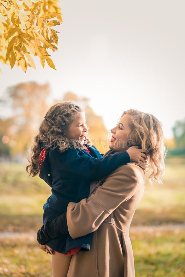 Happy family with children on autumn orange leaf outdoor royalty free stock photos