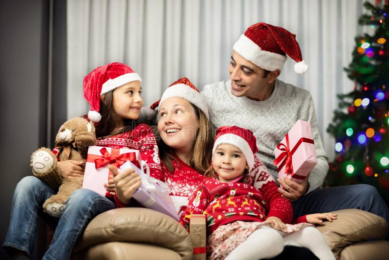 Happy Family with Children Celebrating Christmas Evening stock image