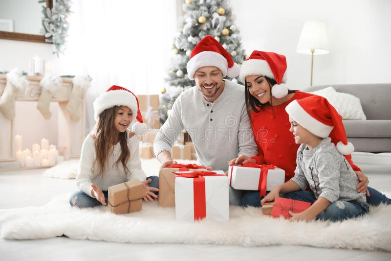 Happy family with children and Christmas gifts on floor royalty free stock photos