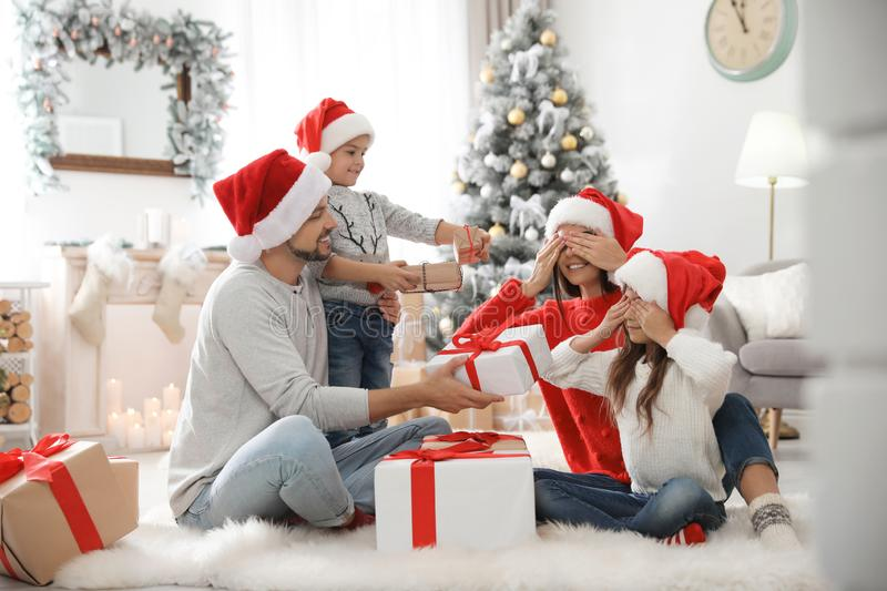 Happy family with children and Christmas gifts on floor royalty free stock image