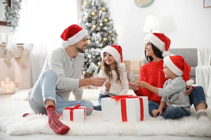 Happy family with children and Christmas gifts on floor. At home royalty free stock images