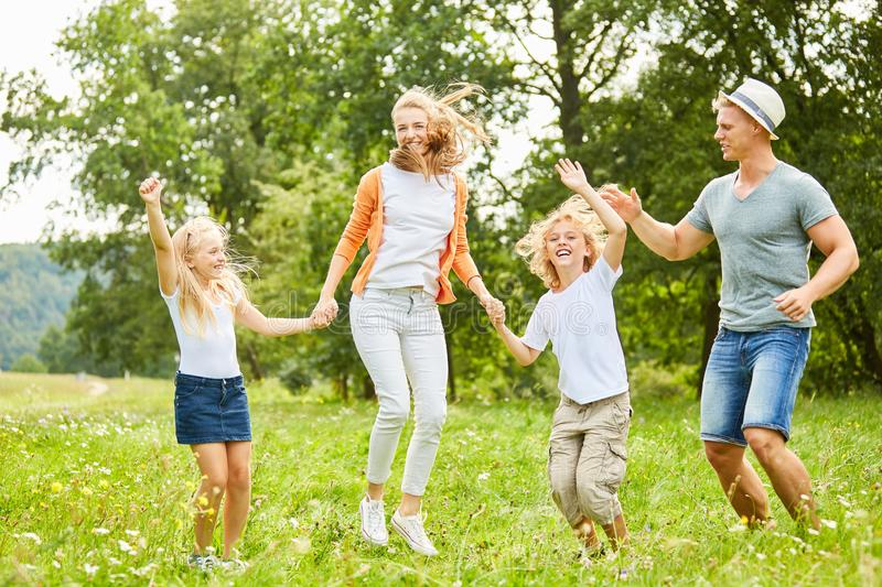 Happy family and children are dancing happily. Happy family and children are happily dancing together in the garden royalty free stock photography