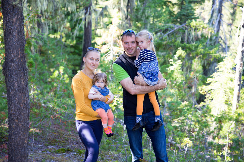 Happy family with children in the mountain forest royalty free stock photography