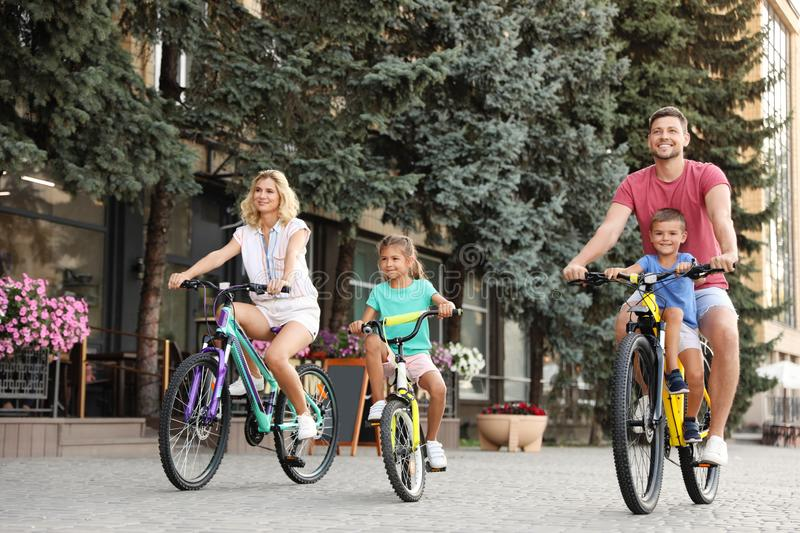 Happy family with children riding bicycles royalty free stock photo