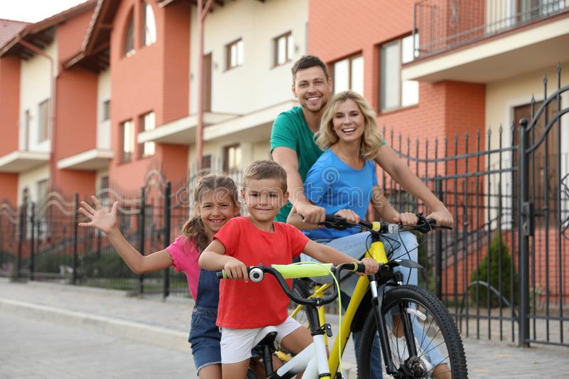 Happy family with children riding bicycles royalty free stock image