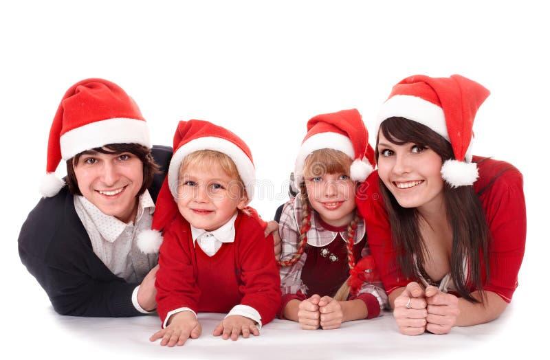 Happy Family With Children In Santa Hat. Stock Photo