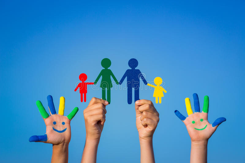 Happy family. Children with smiley on hands against blue summer sky background