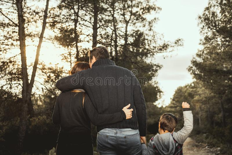 Happy family with children walking through a forest . Family concept in nature stock photos
