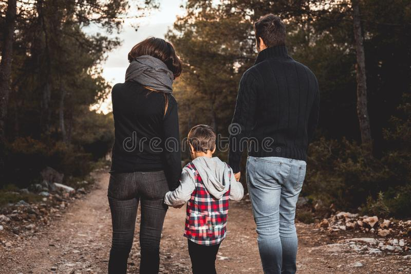 Happy family with children walking through a forest . Family concept in nature royalty free stock image