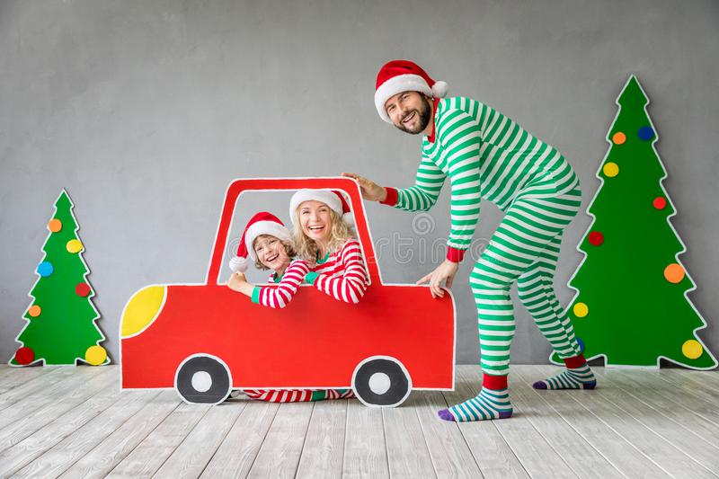 Happy family on Christmas eve. Happy family playing at home. Funny father; mother and child on Christmas eve. Xmas winter holiday concept stock image