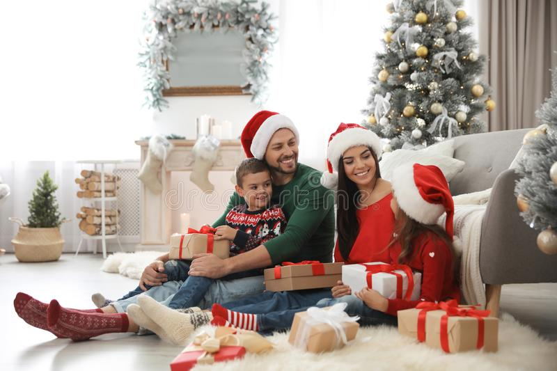Happy family with Christmas gifts on floor stock images