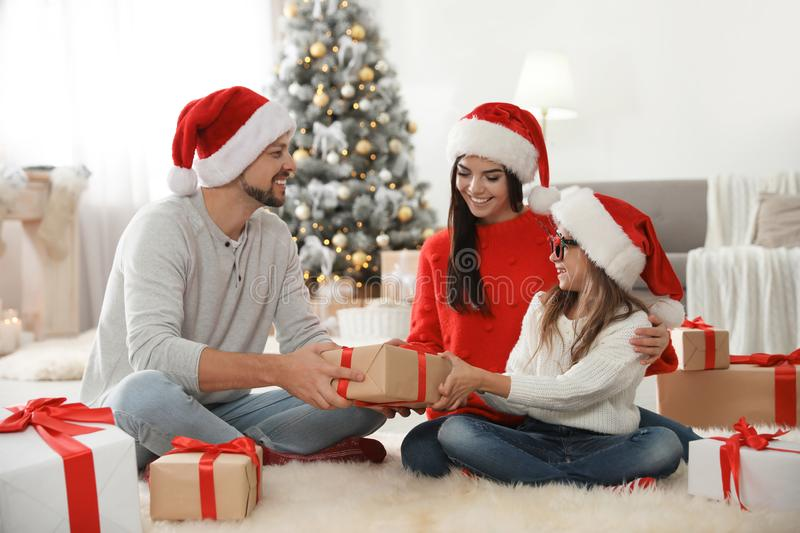 Happy family with Christmas gifts on floor royalty free stock photo