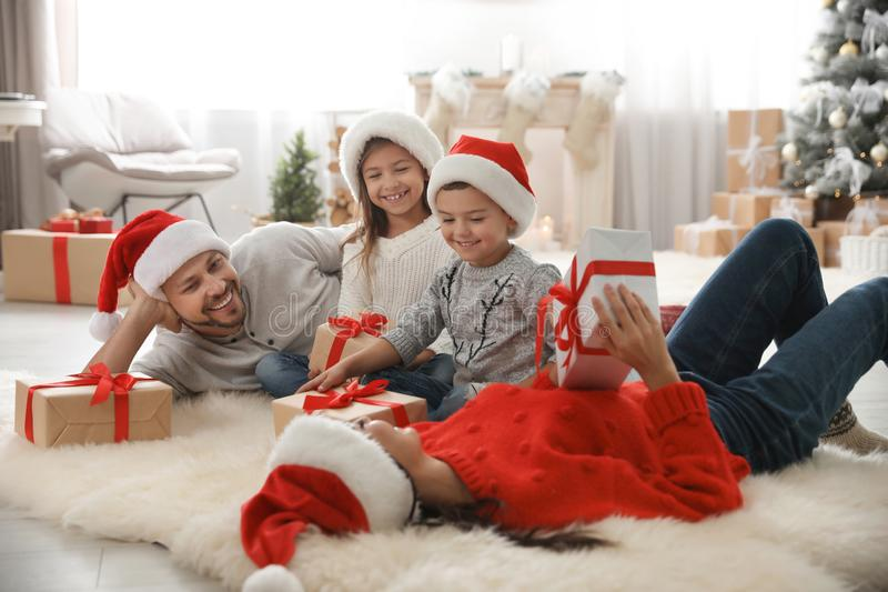 Happy family with Christmas gifts on floor royalty free stock image