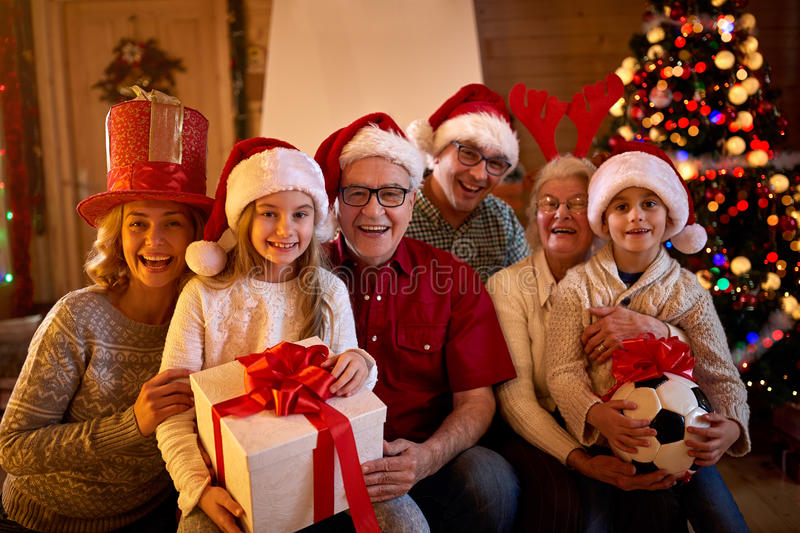 Happy family with Christmas gifts. Portrait happy family with Christmas gifts stock images