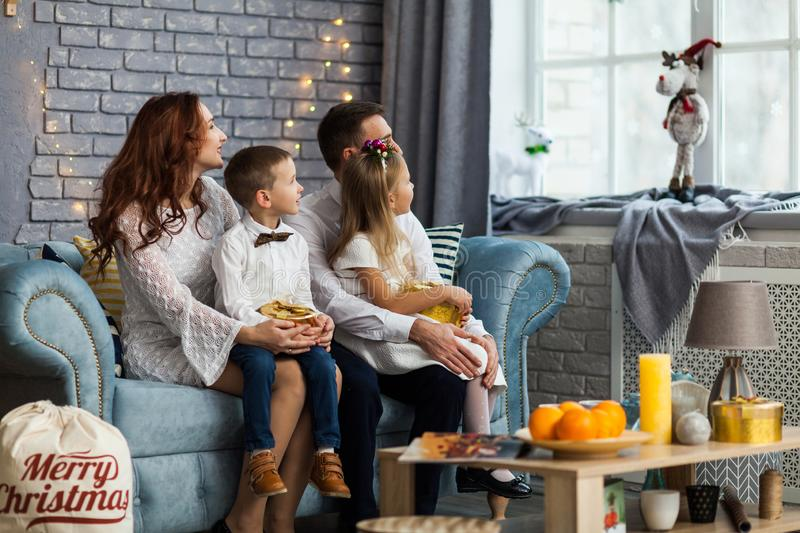 Happy Family before Christmas looking at window stock image