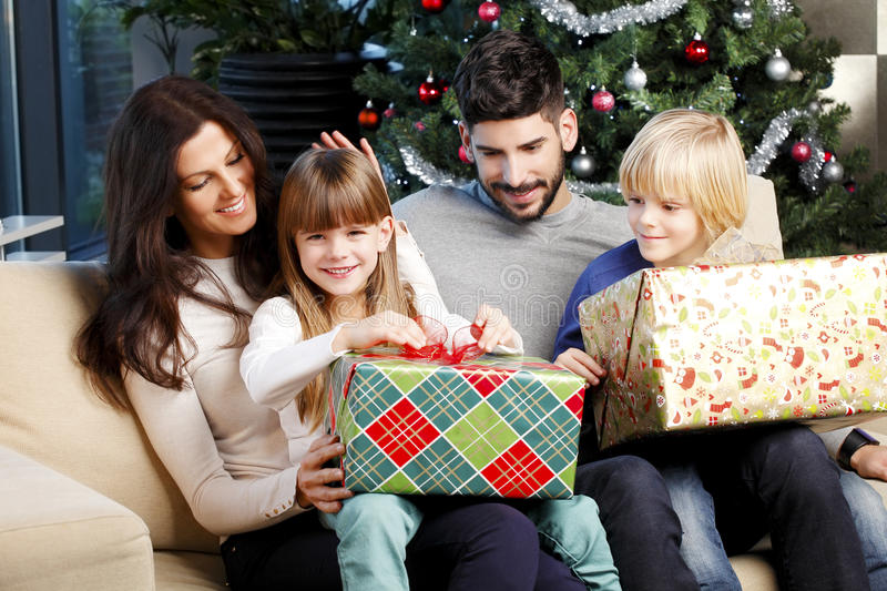 Happy family at christmas stock images