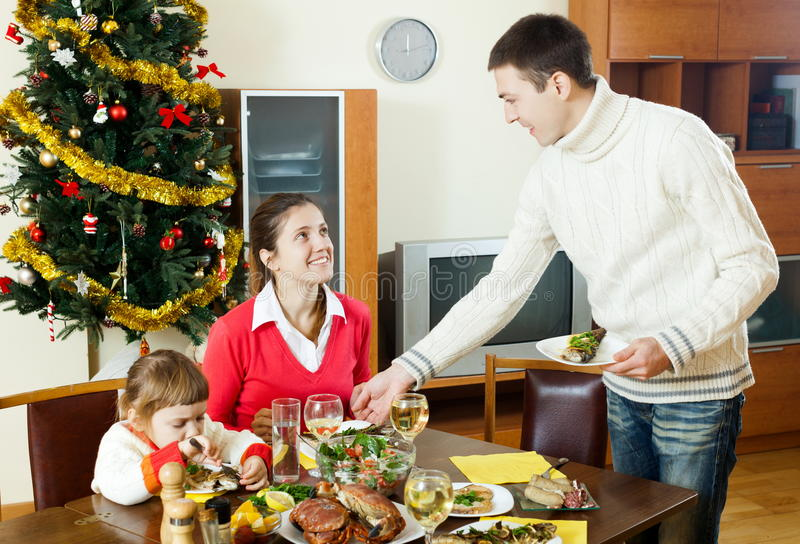 Happy Family At Christmas Time Or Winter Holiday Stock Photo