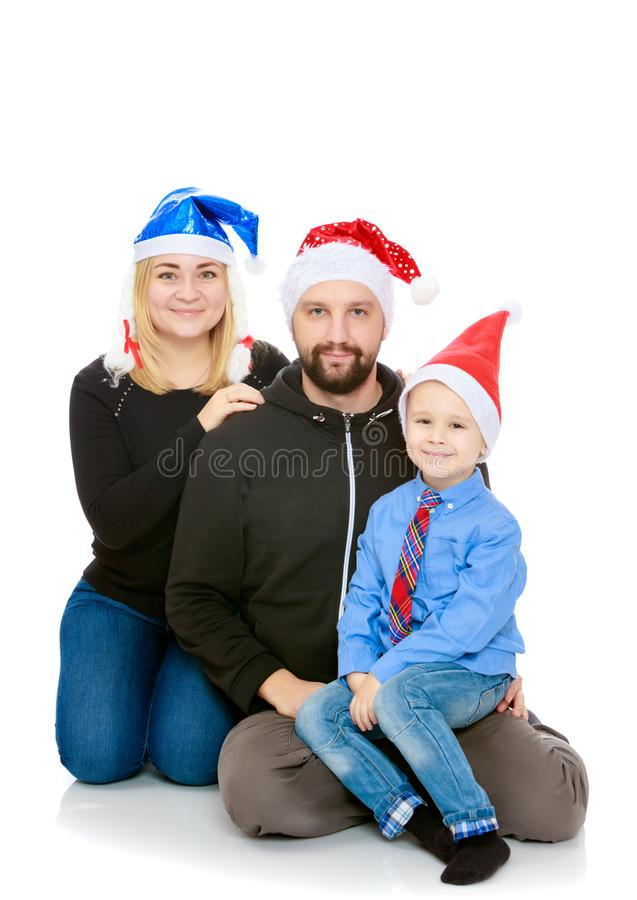 Happy family by the Christmas Tree royalty free stock image