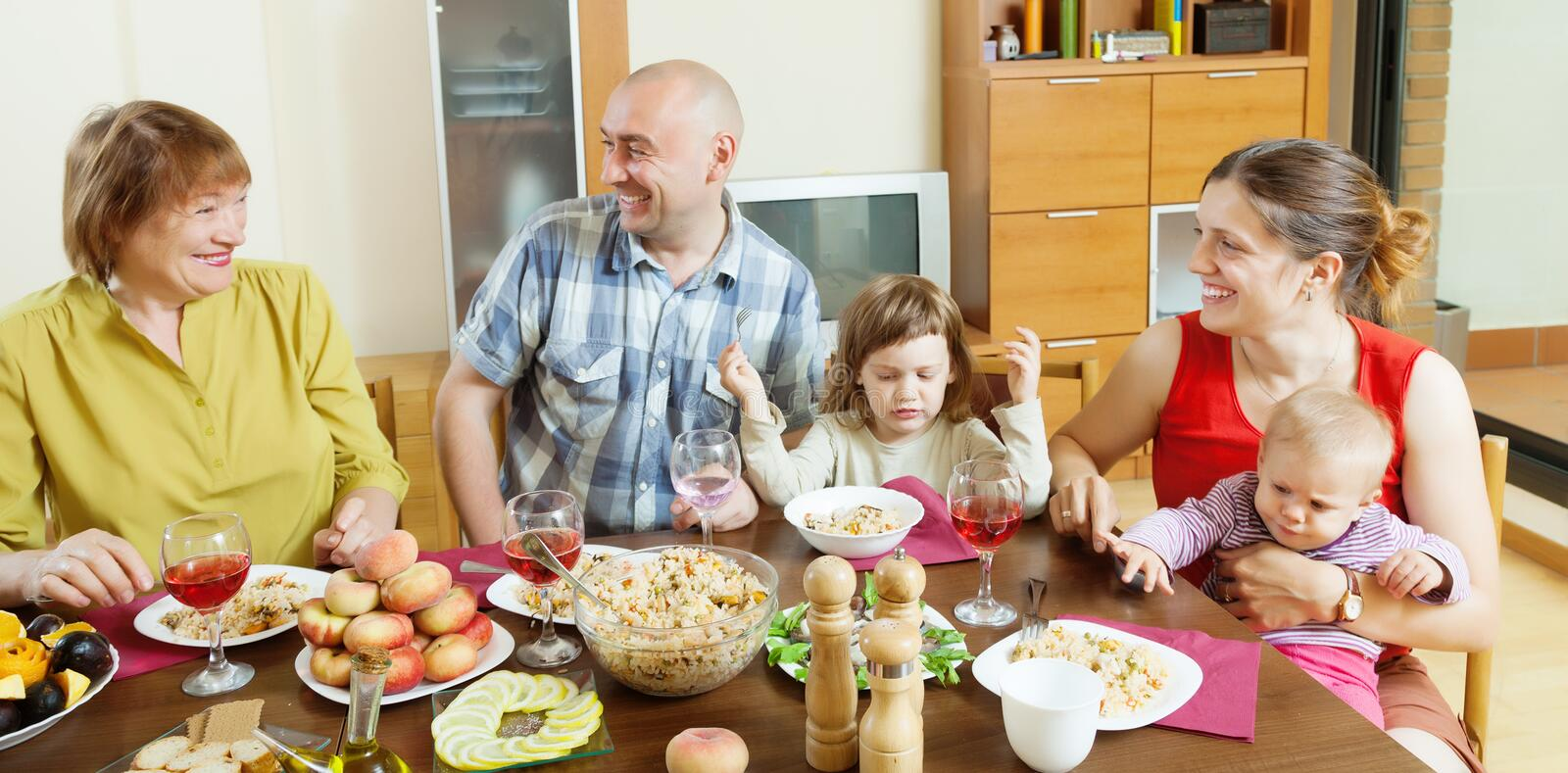 Happy  Family Communicate Over Holiday Table Stock Photo