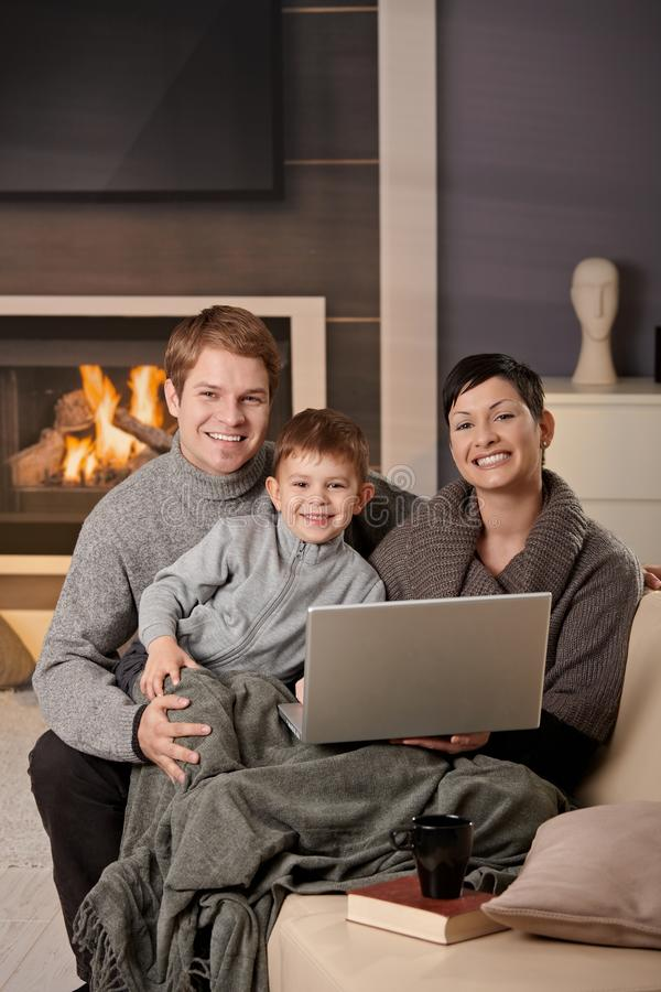 Happy family with computer royalty free stock photography