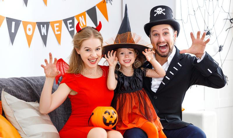 Happy family in costumes getting ready for halloween royalty free stock image