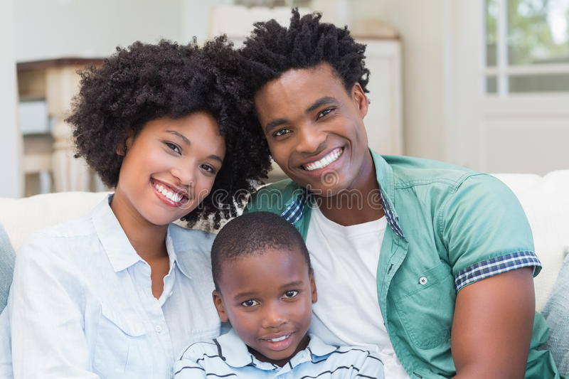 Happy family on the couch. At home in the living room royalty free stock image