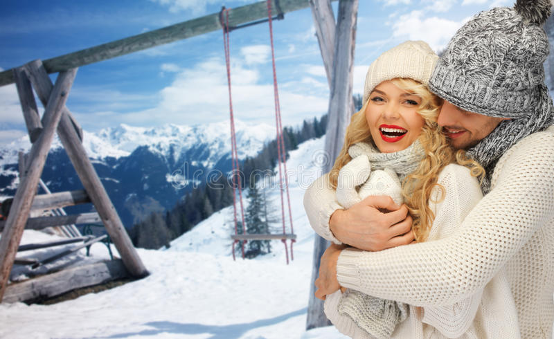Happy family couple in winter clothes hugging stock images