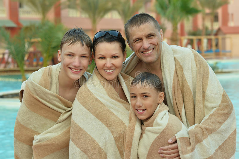 Happy family covered with towels royalty free stock images