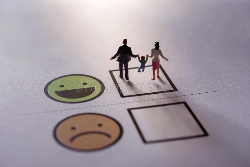 Happy Family Customer Concept. present by Miniature Figure of Fa royalty free stock photos