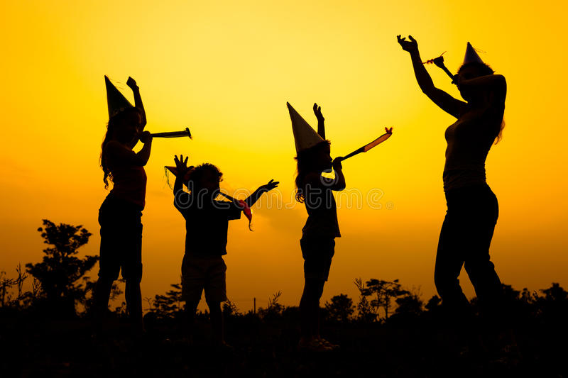 Happy family dancing on the road at the sunset time. Happy family dancing on the road in the sunset time. Evening party on the nature stock photography