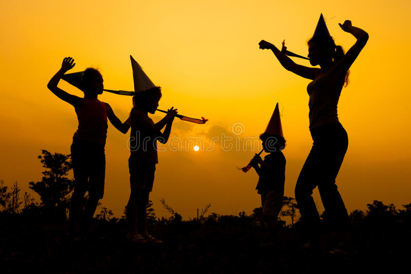 Happy family dancing on the road. At the sunset time. Evening party on the nature stock photos