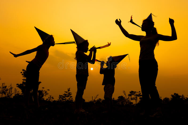 Happy family dancing on the road at the sunset time. Evening. Happy family dancing on the road in the sunset time. Evening party on the nature stock image