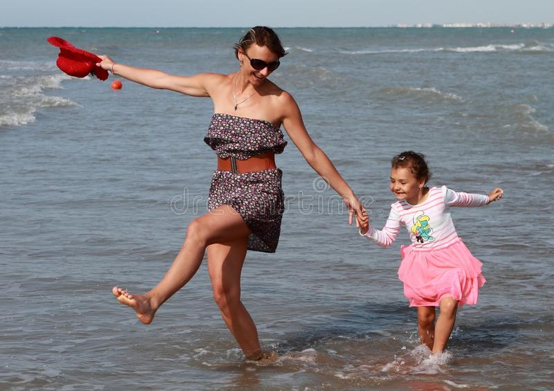 Happy family dancing at sea stock images