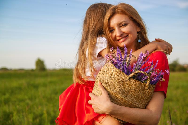 Happy family day. daughter and mother love lavender flower. royalty free stock images