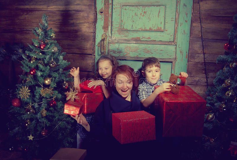 Happy family decorate Christmas tree . stock images