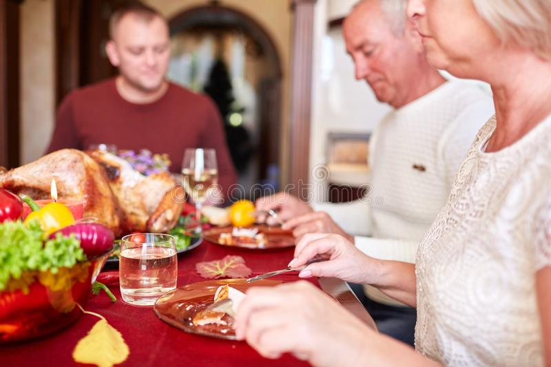 Happy family dining on Christmas on a blurred festive background. Celebrating Thanksgiving concept. Happy new year. royalty free stock image