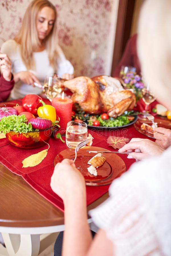 Happy family dining on Christmas on a blurred festive background. Celebrating Thanksgiving concept. Happy new year. royalty free stock photo