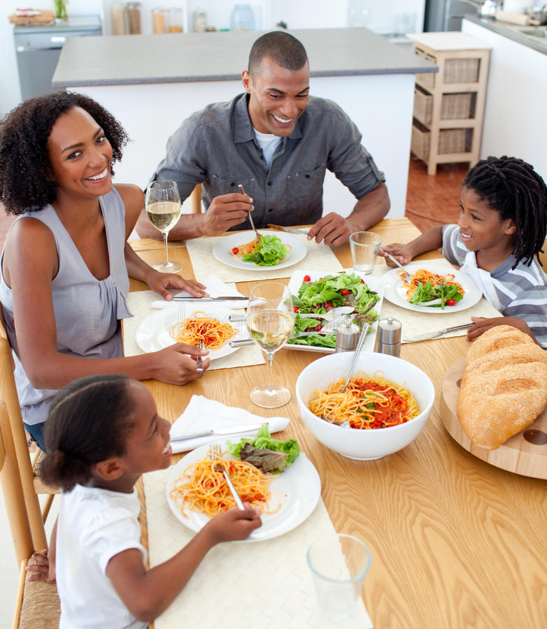 Happy family dining together. In the kitchen stock photography