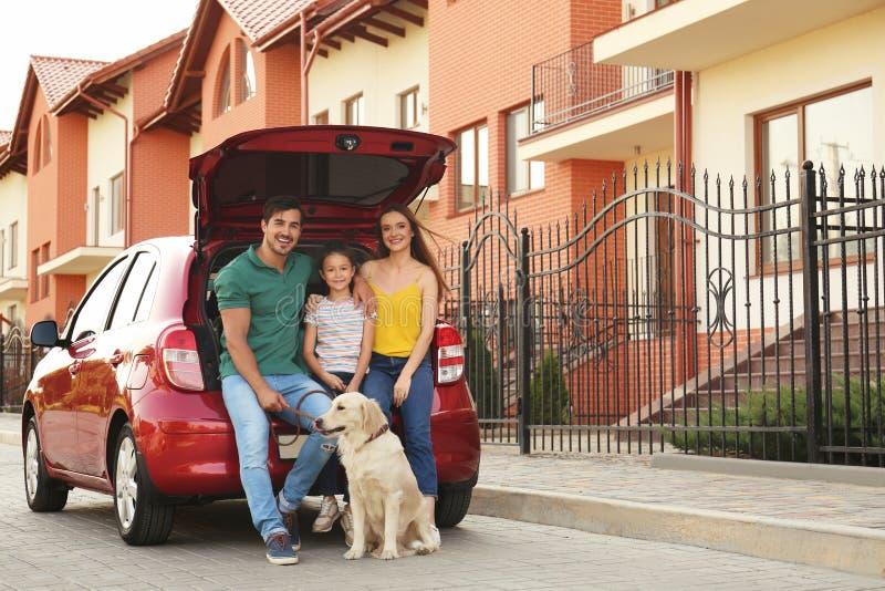 Happy family with dog near car royalty free stock image