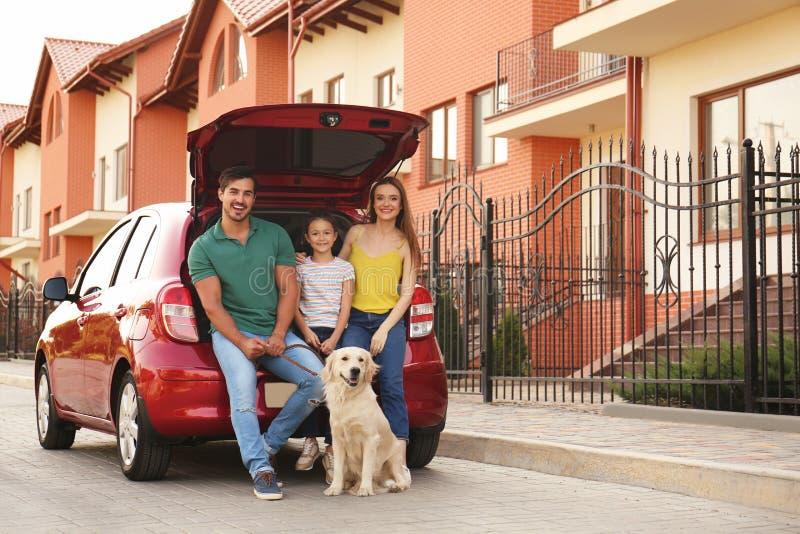 Happy family  dog near car on street stock images