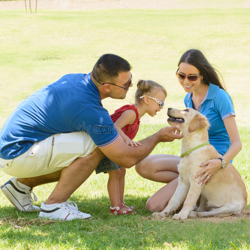 Happy family with a dog royalty free stock images