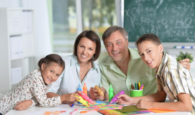 Happy family drawing stock photo
