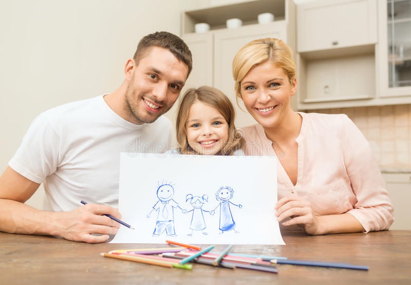 Happy family drawing at home. Family, children and happy people concept - happy family drawing at home stock images