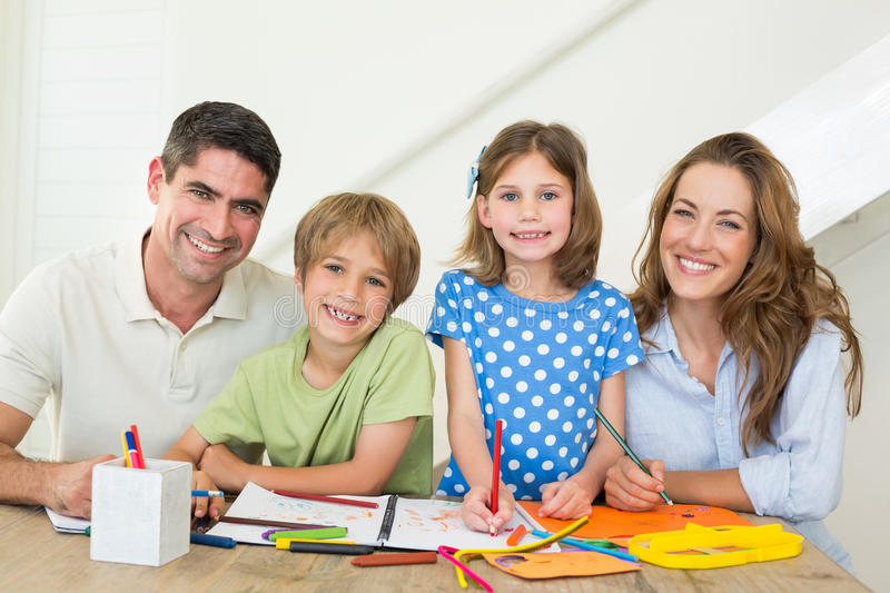 Happy family drawing together royalty free stock photos